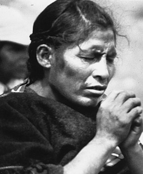 An Aymara woman praying in bolivia